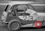 Image of jalopies crashed at demolition derby United Kingdom, 1965, second 20 stock footage video 65675071050