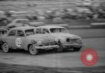 Image of jalopies crashed at demolition derby United Kingdom, 1965, second 30 stock footage video 65675071050