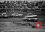 Image of jalopies crashed at demolition derby United Kingdom, 1965, second 51 stock footage video 65675071050