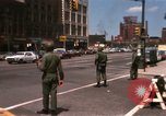 Image of United States soldiers on Guard duty in City Detroit Michigan USA, 1967, second 4 stock footage video 65675071096