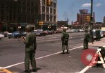 Image of United States soldiers on Guard duty in City Detroit Michigan USA, 1967, second 6 stock footage video 65675071096