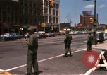 Image of United States soldiers on Guard duty in City Detroit Michigan USA, 1967, second 7 stock footage video 65675071096