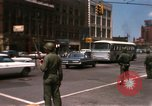 Image of United States soldiers on Guard duty in City Detroit Michigan USA, 1967, second 12 stock footage video 65675071096
