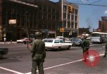 Image of United States soldiers on Guard duty in City Detroit Michigan USA, 1967, second 14 stock footage video 65675071096