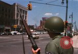 Image of United States soldiers on Guard duty in City Detroit Michigan USA, 1967, second 16 stock footage video 65675071096