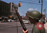 Image of United States soldiers on Guard duty in City Detroit Michigan USA, 1967, second 17 stock footage video 65675071096