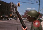 Image of United States soldiers on Guard duty in City Detroit Michigan USA, 1967, second 18 stock footage video 65675071096