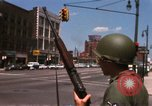 Image of United States soldiers on Guard duty in City Detroit Michigan USA, 1967, second 19 stock footage video 65675071096