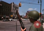 Image of United States soldiers on Guard duty in City Detroit Michigan USA, 1967, second 20 stock footage video 65675071096