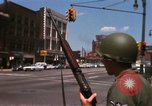 Image of United States soldiers on Guard duty in City Detroit Michigan USA, 1967, second 22 stock footage video 65675071096