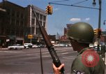 Image of United States soldiers on Guard duty in City Detroit Michigan USA, 1967, second 23 stock footage video 65675071096