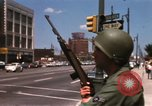 Image of United States soldiers on Guard duty in City Detroit Michigan USA, 1967, second 28 stock footage video 65675071096