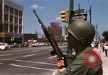 Image of United States soldiers on Guard duty in City Detroit Michigan USA, 1967, second 29 stock footage video 65675071096