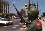 Image of United States soldiers on Guard duty in City Detroit Michigan USA, 1967, second 30 stock footage video 65675071096