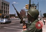Image of United States soldiers on Guard duty in City Detroit Michigan USA, 1967, second 32 stock footage video 65675071096