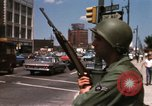 Image of United States soldiers on Guard duty in City Detroit Michigan USA, 1967, second 38 stock footage video 65675071096