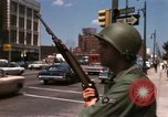 Image of United States soldiers on Guard duty in City Detroit Michigan USA, 1967, second 42 stock footage video 65675071096