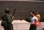 Image of United States soldiers on Guard duty in City Detroit Michigan USA, 1967, second 49 stock footage video 65675071096