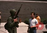 Image of United States soldiers on Guard duty in City Detroit Michigan USA, 1967, second 51 stock footage video 65675071096