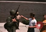 Image of United States soldiers on Guard duty in City Detroit Michigan USA, 1967, second 57 stock footage video 65675071096