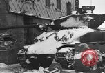 Image of US Soldiers examine damaged US M4 and German Panther tank Sterpigny Belgium, 1945, second 7 stock footage video 65675071156