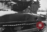 Image of US Soldiers examine damaged US M4 and German Panther tank Sterpigny Belgium, 1945, second 11 stock footage video 65675071156