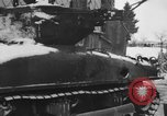 Image of US Soldiers examine damaged US M4 and German Panther tank Sterpigny Belgium, 1945, second 13 stock footage video 65675071156
