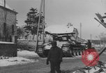 Image of US Soldiers examine damaged US M4 and German Panther tank Sterpigny Belgium, 1945, second 36 stock footage video 65675071156