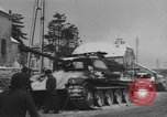 Image of US Soldiers examine damaged US M4 and German Panther tank Sterpigny Belgium, 1945, second 41 stock footage video 65675071156
