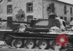 Image of US Soldiers examine damaged US M4 and German Panther tank Sterpigny Belgium, 1945, second 43 stock footage video 65675071156