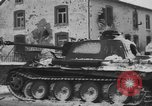 Image of US Soldiers examine damaged US M4 and German Panther tank Sterpigny Belgium, 1945, second 45 stock footage video 65675071156