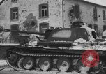 Image of US Soldiers examine damaged US M4 and German Panther tank Sterpigny Belgium, 1945, second 46 stock footage video 65675071156