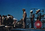 Image of Religious services at a bomb crater on Midway Island Pacific Ocean, 1942, second 18 stock footage video 65675071189