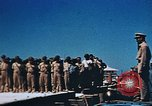 Image of Religious services at a bomb crater on Midway Island Pacific Ocean, 1942, second 21 stock footage video 65675071189