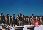 Image of Religious services at a bomb crater on Midway Island Pacific Ocean, 1942, second 25 stock footage video 65675071189