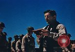 Image of Religious services at a bomb crater on Midway Island Pacific Ocean, 1942, second 30 stock footage video 65675071189