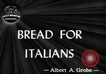 Image of bread supplied to Italian citizens in World War 2 Italy, 1944, second 1 stock footage video 65675071256