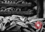 Image of bread supplied to Italian citizens in World War 2 Italy, 1944, second 25 stock footage video 65675071256