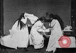 Image of Pillow fight West Orange New Jersey USA, 1897, second 10 stock footage video 65675071524