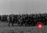 Image of German troops marching on a rough field Germany, 1933, second 13 stock footage video 65675071553