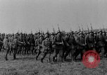 Image of German troops marching on a rough field Germany, 1933, second 14 stock footage video 65675071553