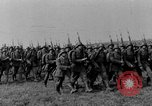 Image of German troops marching on a rough field Germany, 1933, second 15 stock footage video 65675071553