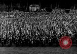 Image of German troops marching on a rough field Germany, 1933, second 17 stock footage video 65675071553