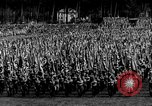 Image of German troops marching on a rough field Germany, 1933, second 20 stock footage video 65675071553