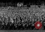 Image of German troops marching on a rough field Germany, 1933, second 21 stock footage video 65675071553
