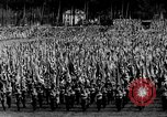 Image of German troops marching on a rough field Germany, 1933, second 22 stock footage video 65675071553