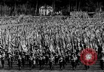 Image of German troops marching on a rough field Germany, 1933, second 23 stock footage video 65675071553