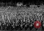 Image of German troops marching on a rough field Germany, 1933, second 24 stock footage video 65675071553
