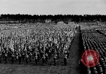 Image of German troops marching on a rough field Germany, 1933, second 25 stock footage video 65675071553