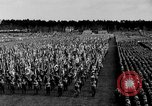 Image of German troops marching on a rough field Germany, 1933, second 27 stock footage video 65675071553